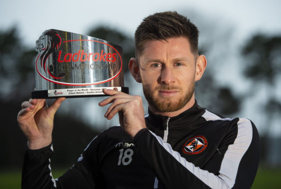 Calum Butcher with his player of the month award.