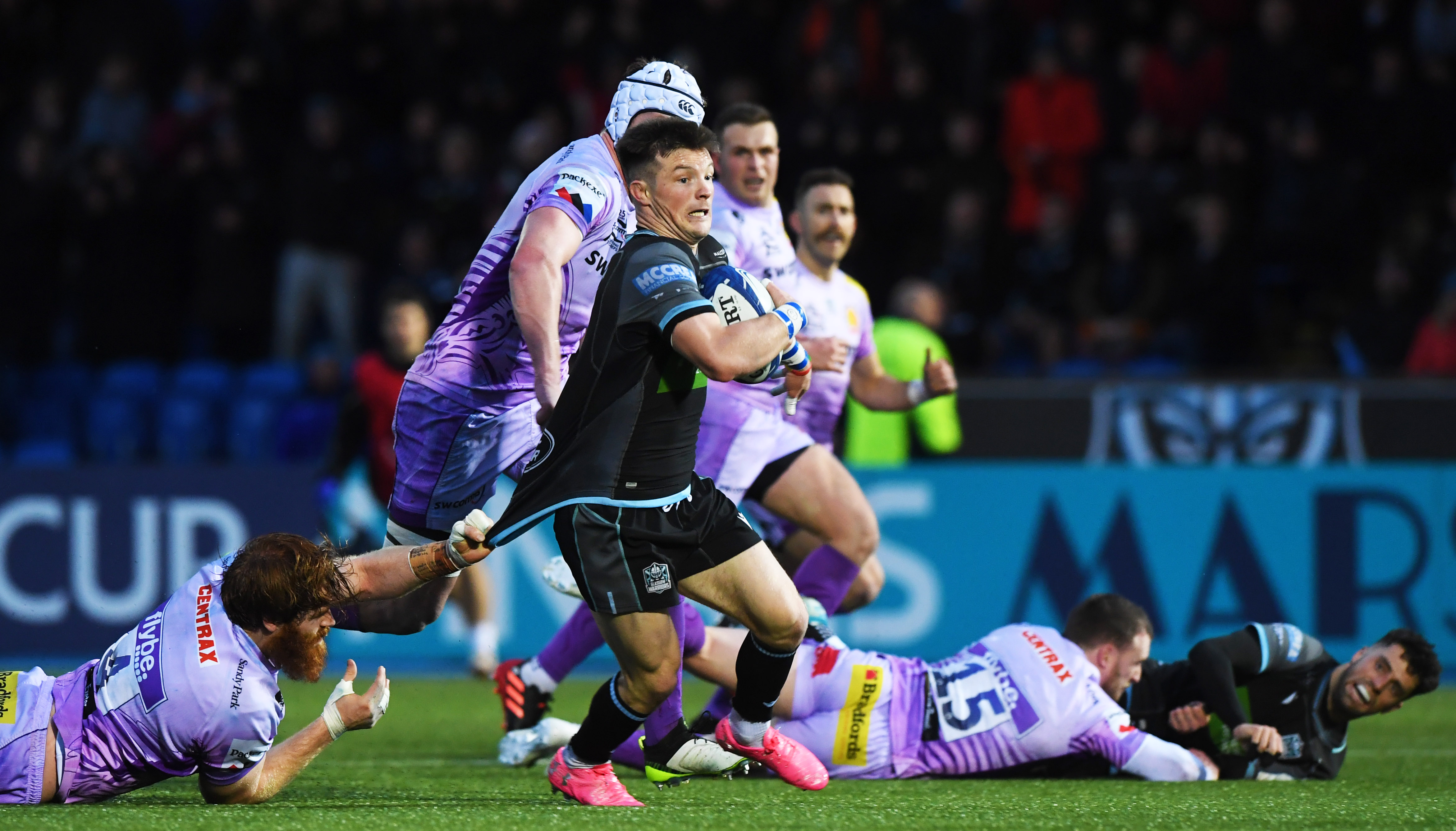 George Horne drives through for Glasgow's third try against Exeter at Scotstoun.