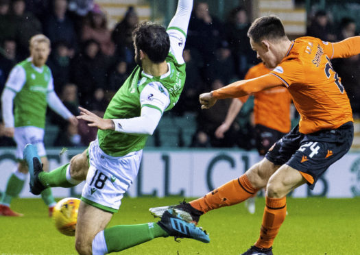 Lawrence Shankland scores against Hibs.