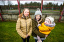 Steph Erskine and Ann-Marie Black with baby Sophie at the all weather pitch where the fence is being vandalised to gain access