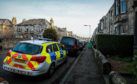 Police on David Street, Kirkcaldy, after the alleged incident.
