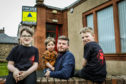 Volunteer Aiden Hayles (7), Arran Hayles (2), Wayne Hayles (43) and Volunteer Logan Hayles (9) outside Moray Institute where they propose to host the Community Cinema