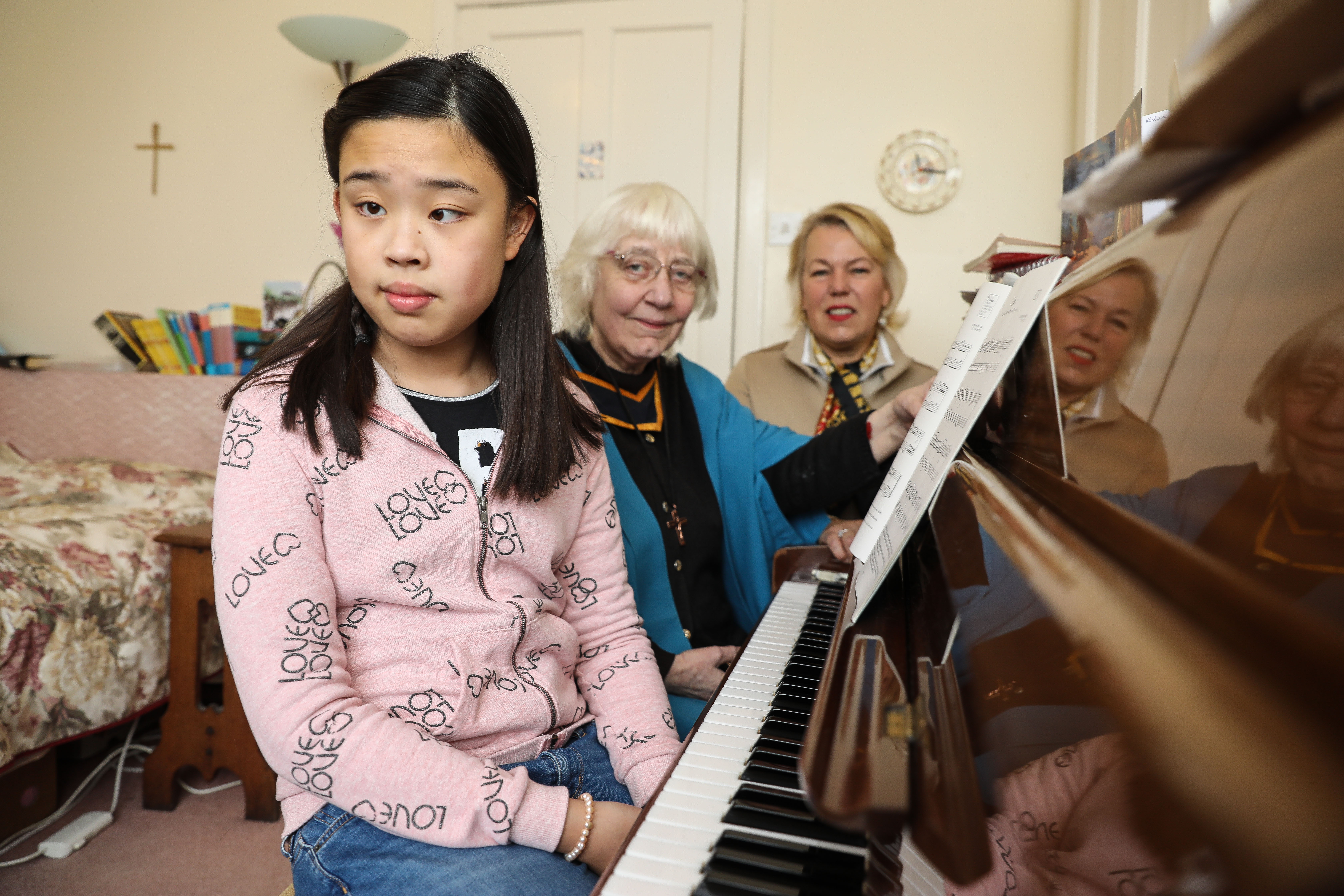 Fife youngster Zimeng Chen with piano tutor Sister Avril Landay and Maggie Picken from Skiffington Trust.