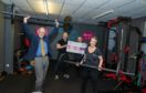 Scotland All-Strong fitness studio is celebrating a Lottery windfall for its Fitness to Feel Better Programme.  Deputy First Minister John Swinney MSP was on hand along with Neil Ritch Scotland Director National Lottery Community fund to hand over the cheque to Owner Andy Douglas and his wife Jessica.