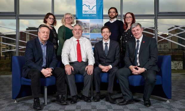 From back left, Lauren Miller Business Gateway, Alison Henderson Dundee & Angus Chamber of Commerce, Brian McNicoll University of Dundee, Gill Simpson Scottish Enterprise, front, councillors Angus Forbes Perth & Kinross Council, Tommy Stewart Angus Council, John Alexander Dundee City Council  and Councillor  Craik Fife Council.