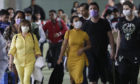 Passengers wear masks as they arrive at Manila's international airport, Philippines. The government is closely monitoring arrival of passengers as a new coronavirus outbreak in Wuhan, China has infected hundreds and caused deaths in that area.