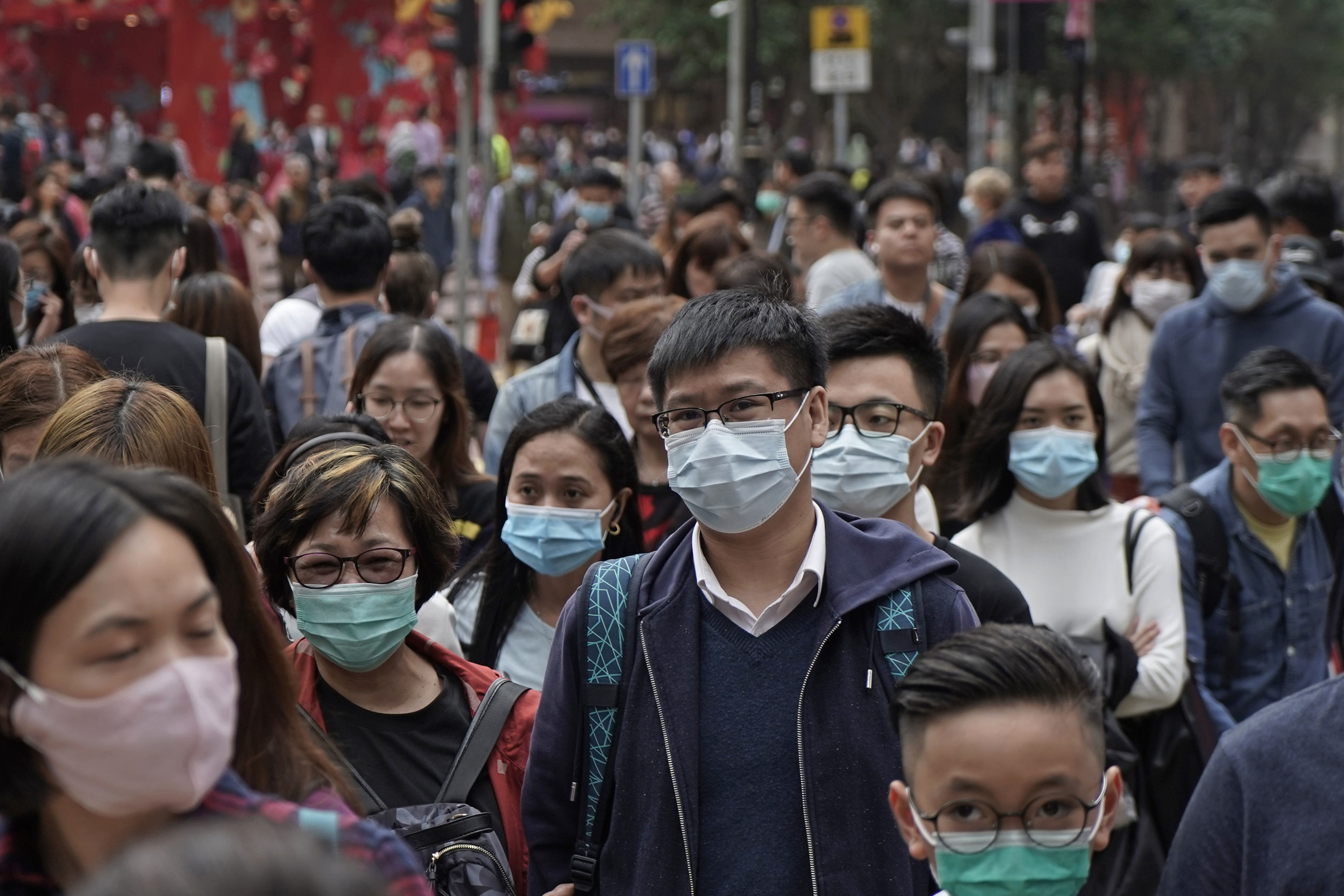 People wear masks on a street in Hong Kong,