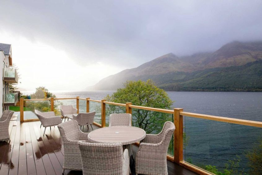 Some of the rooms at Whispering Pine Lodge have a balcony with stunning views of Loch Lochy.