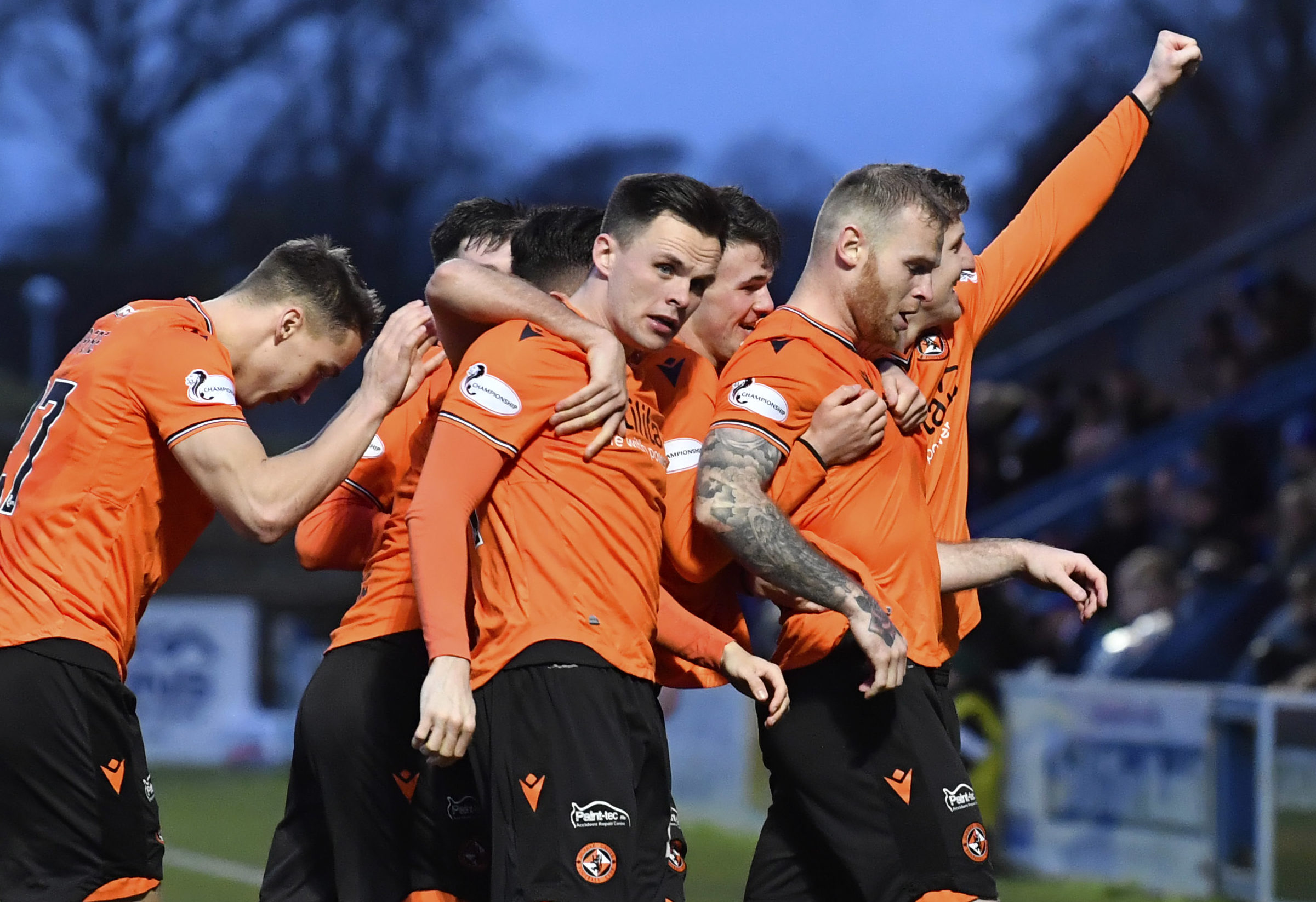 The United players celebrate with Mark Connolly.