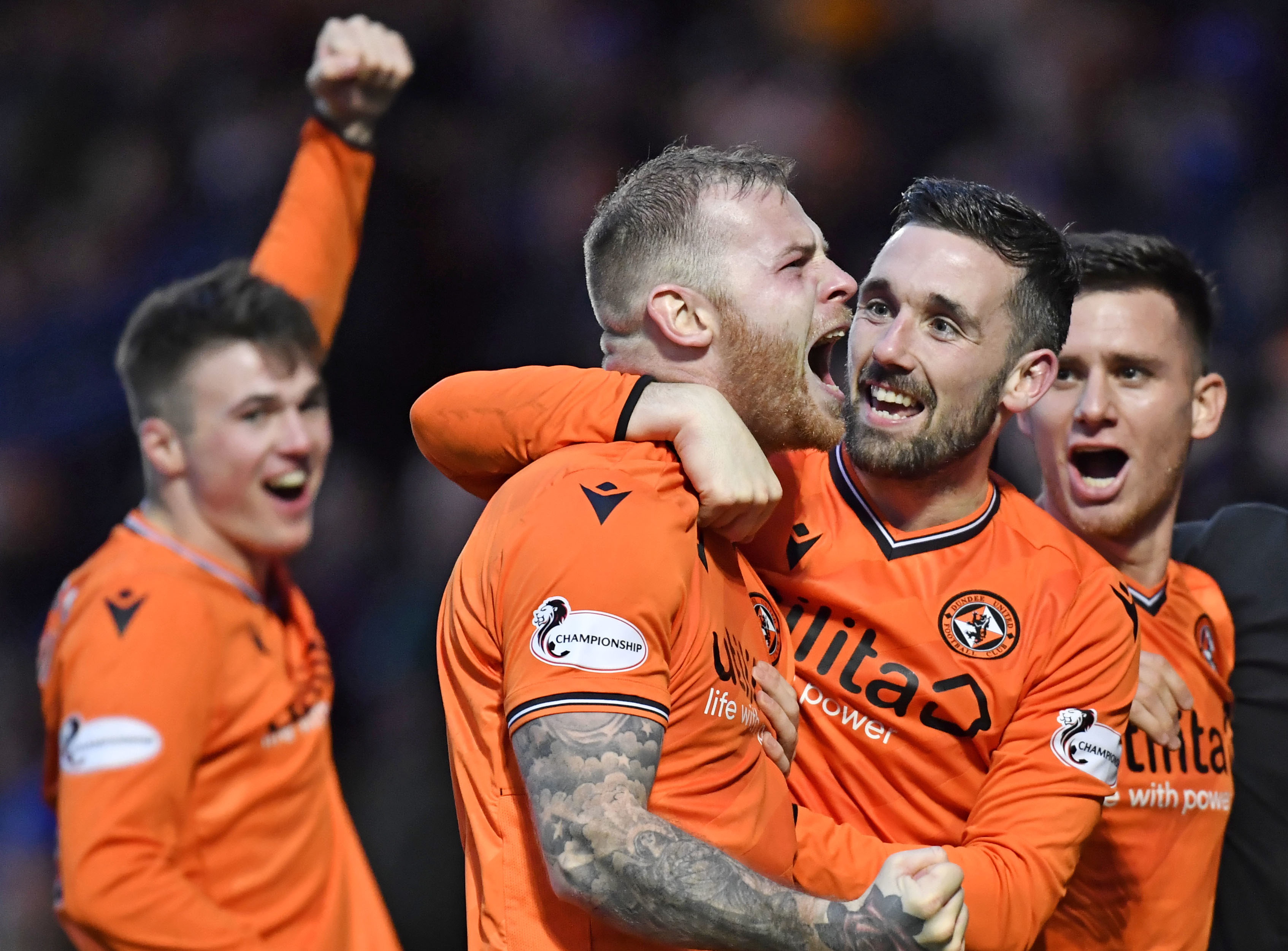 Dundee United defender Mark Connolly (centre) is relishing the test of the Premiership.