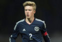 Kieran Freeman in action for Scotland.