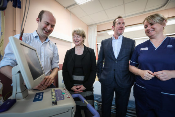 Dr Matthew Lambert, Consultant and Clinical Lead for Stroke in Ninewells, Shona Robison MSP, Stroke Association Colin Oliver and Senior Charge Nurse Fay Cunningham with an ECG machine.