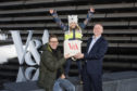Philip Long, director of V&A Dundee, presents Jan Becker and his daughter Nalani, 7, from Berlin with a goody bag.