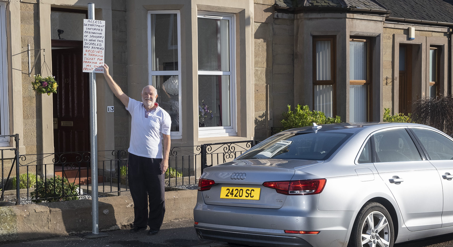 Alexander Cowie, 80, outside his home.