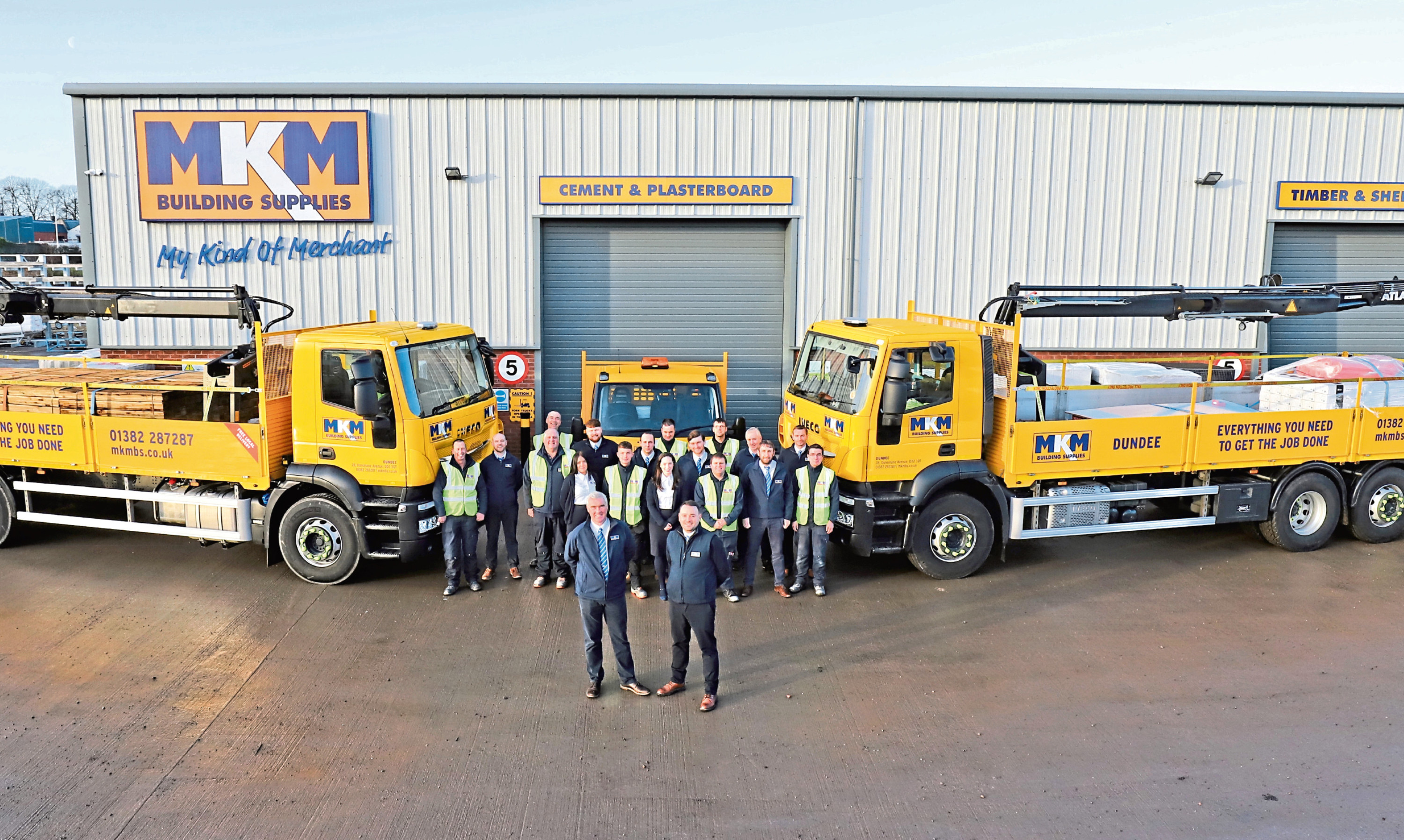 MKM Building Supplies Dundee branch directors Barclay Scott and Ross MacGregor with staff.