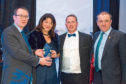 The NFUS Membership Flame was presented to the union's Perth team.
