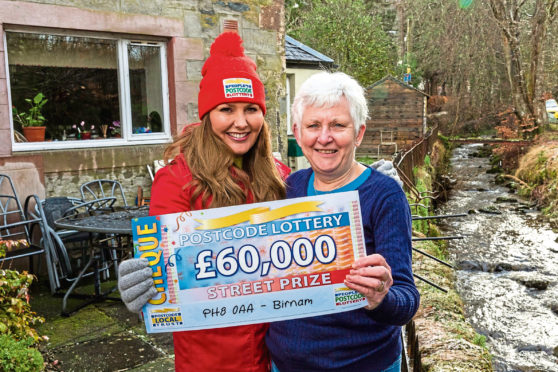 Dunkeld resident Evelyn Menzies and People's Postcode Lottery ambassador Judie McCourt.