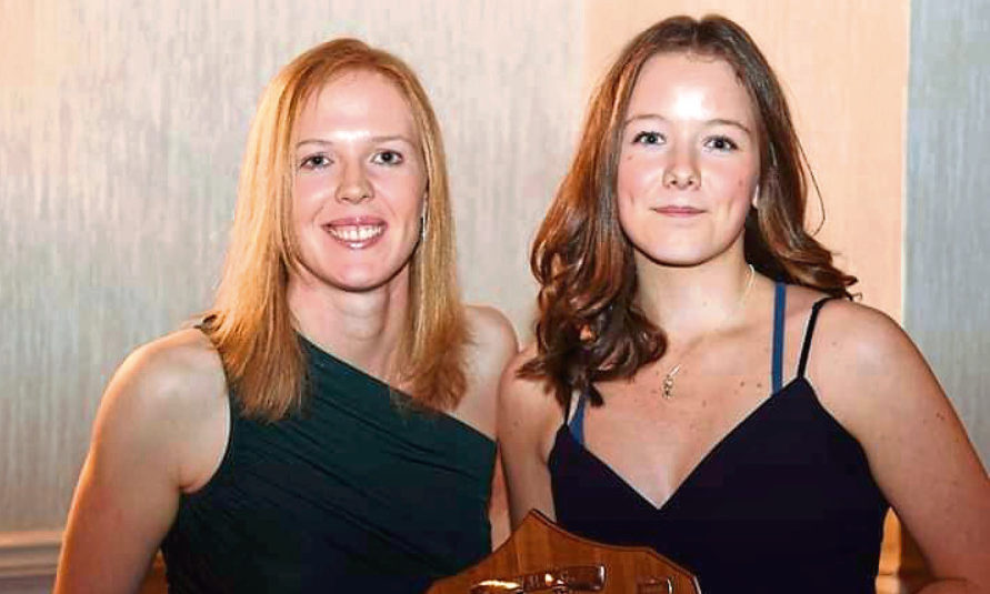 13-year-old Perth High pupil Chloe Grant (right) was presented the BWRDC Barbara E Bird Trophy for the British Women Racing by Junior Champion by Alice Powell who currently races in the W Series.