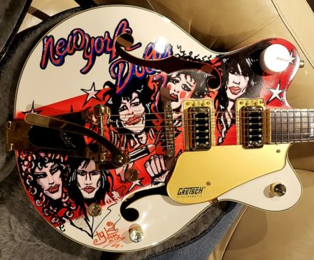 The one-off guitar has been signed by a host of rock legends.