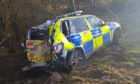 The damaged police vehicle.