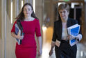 Kate Forbes, on her way to deliver the Scottish Government's budget proposals having been drafted in at the last minute, with First Minister Nicola Sturgeon.
