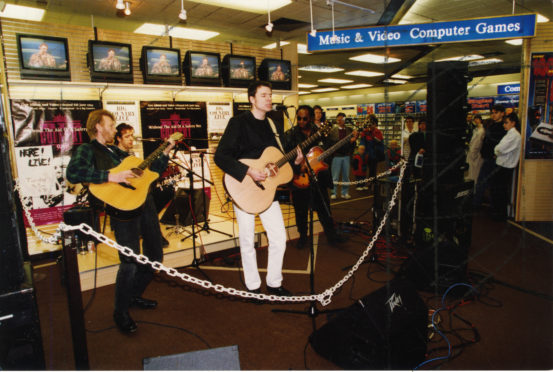 Big Country performing a record store gig in Dundee in 1994.