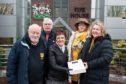 Bob Main, vice chairman, and Bridget Fraser, chairwoman, of Burntisland Amateur Swimming Club, hand the petition to Cllr Judy Hamilton, with Cllr Gordon Langlands, and Cllr Lesley Backhouse behind