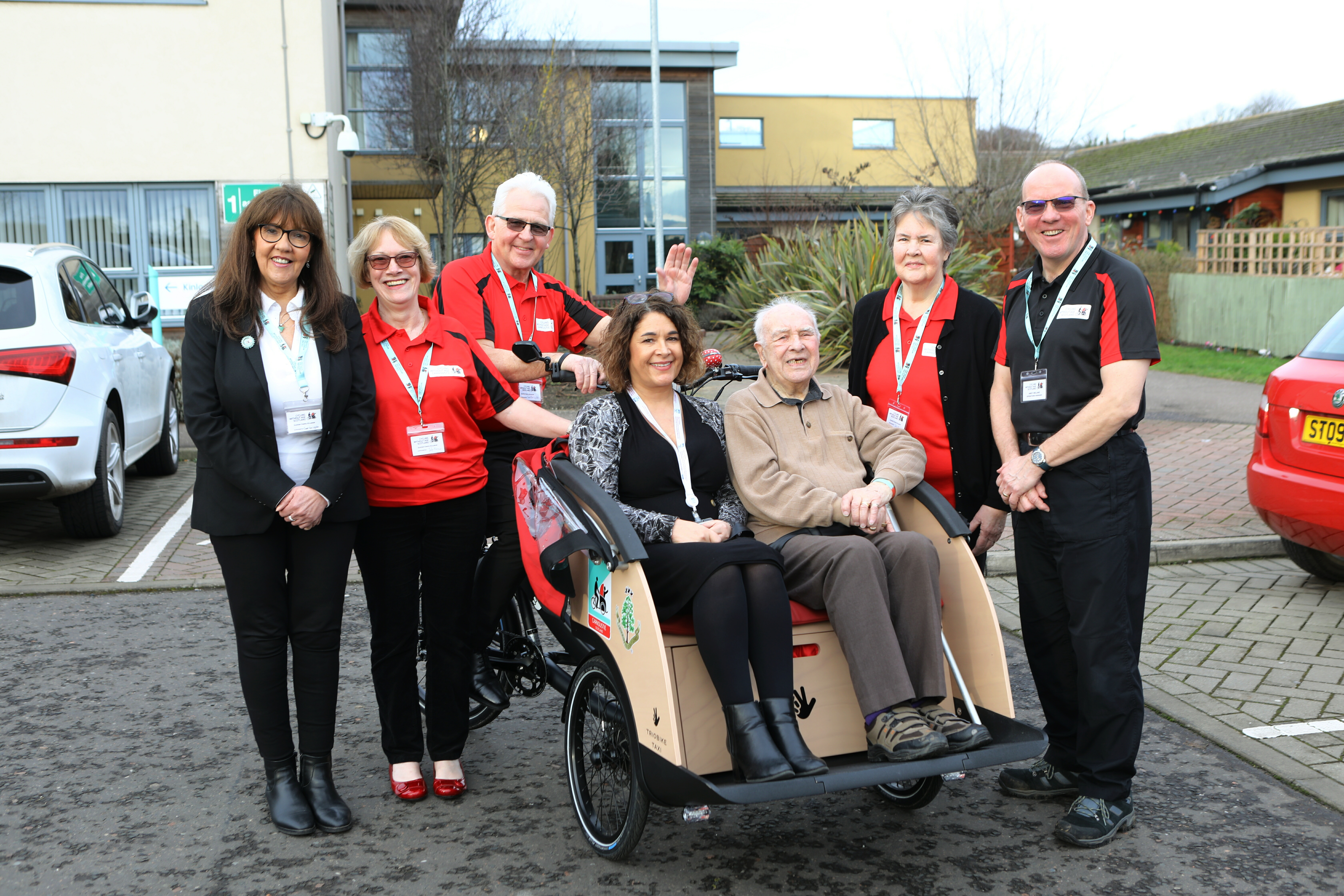 At the Kinloch Care Centre launch of the Carnoustie Cycling Without Age initiative (from left) Christine Bell, Executive Officer, Cycling Without Age Scotland; Lorraine Young, chapter co-organiser; pilot Bruce Crawford, chapter co-organiser Jean Brown,  Andrew Ireland. CWA Scotland operations manager, care centre manager Carol Brunton and John Robertson in the trishaw.