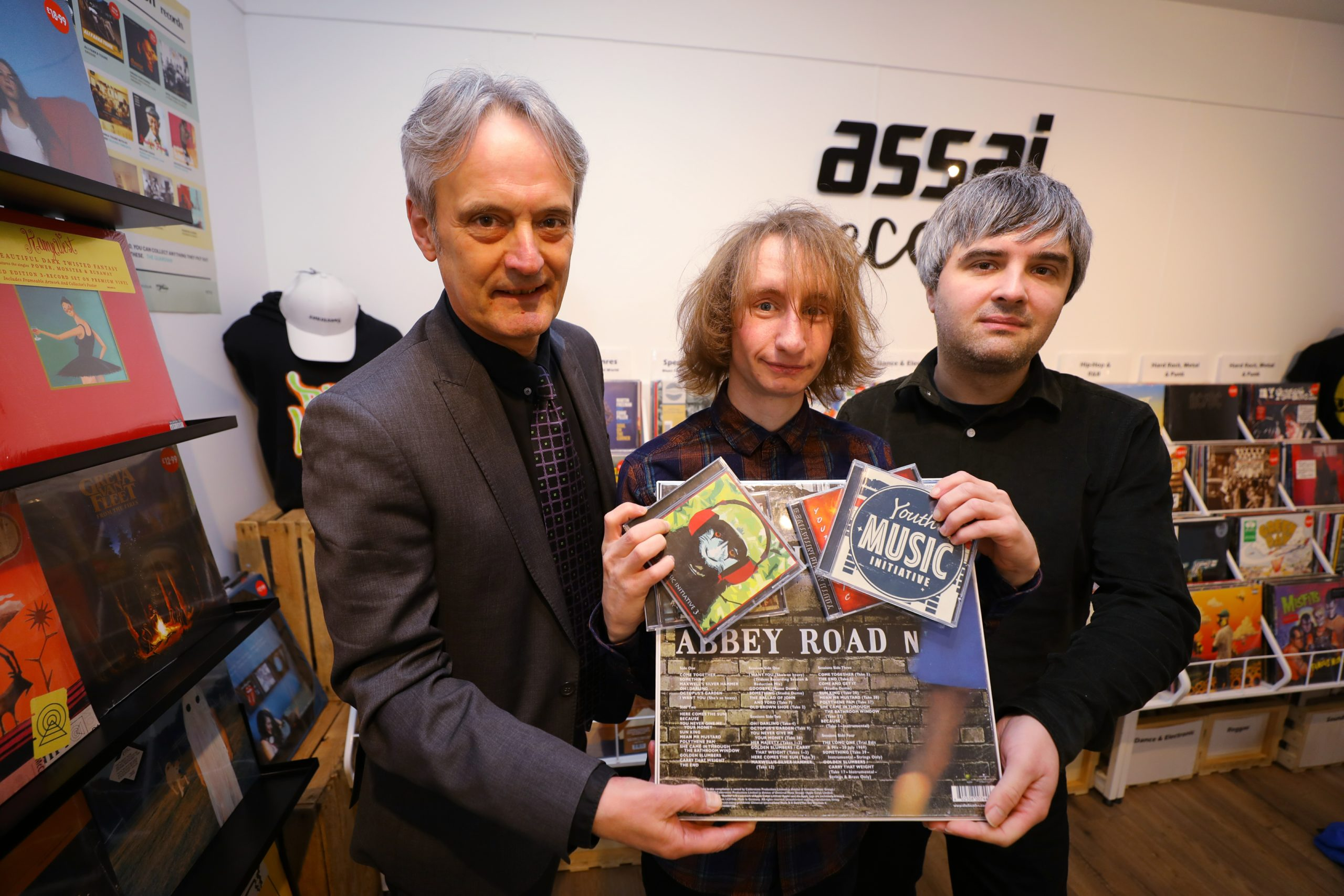 Marley Davidson, with Grant Ritchie, left, Principal of Dundee & Angus College, and Matthew Marra - Shop Manager, in Assai Records.
