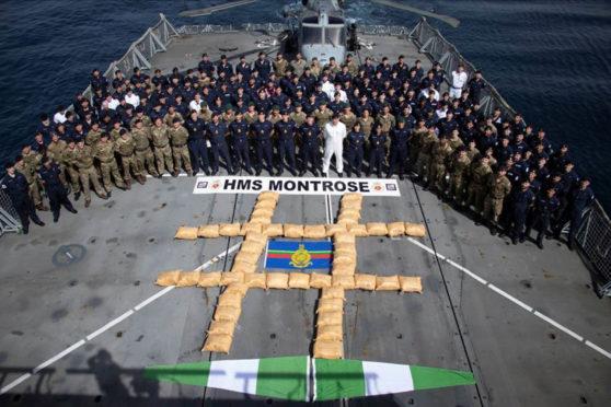 HMS Montrose crew with the massive haul of hashish.