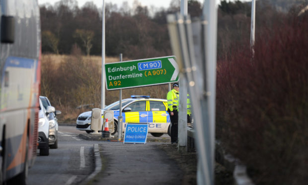 Police at the scene of the crash on the A92 near the Cowdenbeath access slip.