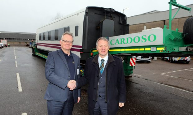 Parc CEO John Reid welcomes Ivan McKee, minister for Trade,Investment & Innovation who is opening the event, with a Talgo high speed electric train carraige. Pic by G Jennings.