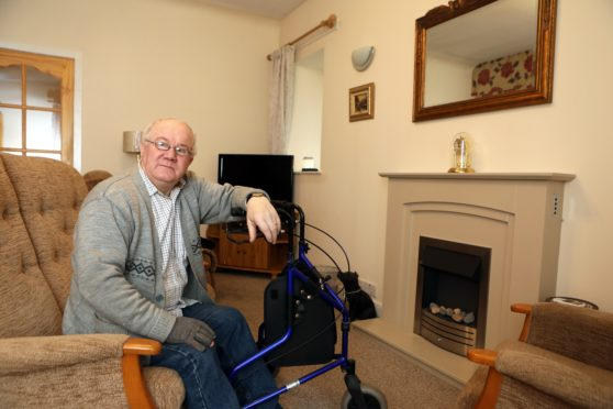 Jim Baker, 70, in the living room of his Carnoustie home.