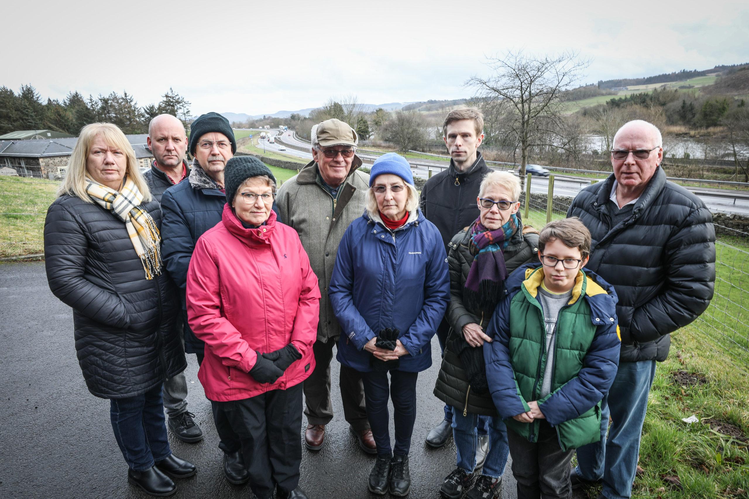 Councillor Alasdair Bailey with local residents at the busy A90 dual carraigeway