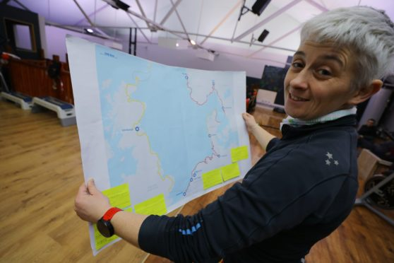 Louise Johnstone with a map of the route she plans to run.