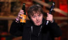 Lewis Capaldi with his Song of the Year award and a bottle of Buckfast on stage at the Brit Awards 2020 at the O2 Arena, London.