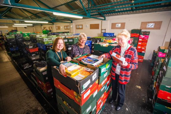 Lynn-Marie Neil (project coordinator) alongside volunteers Lena and Dorothy at Perth Foodbank. Picture: Steve MacDougall.