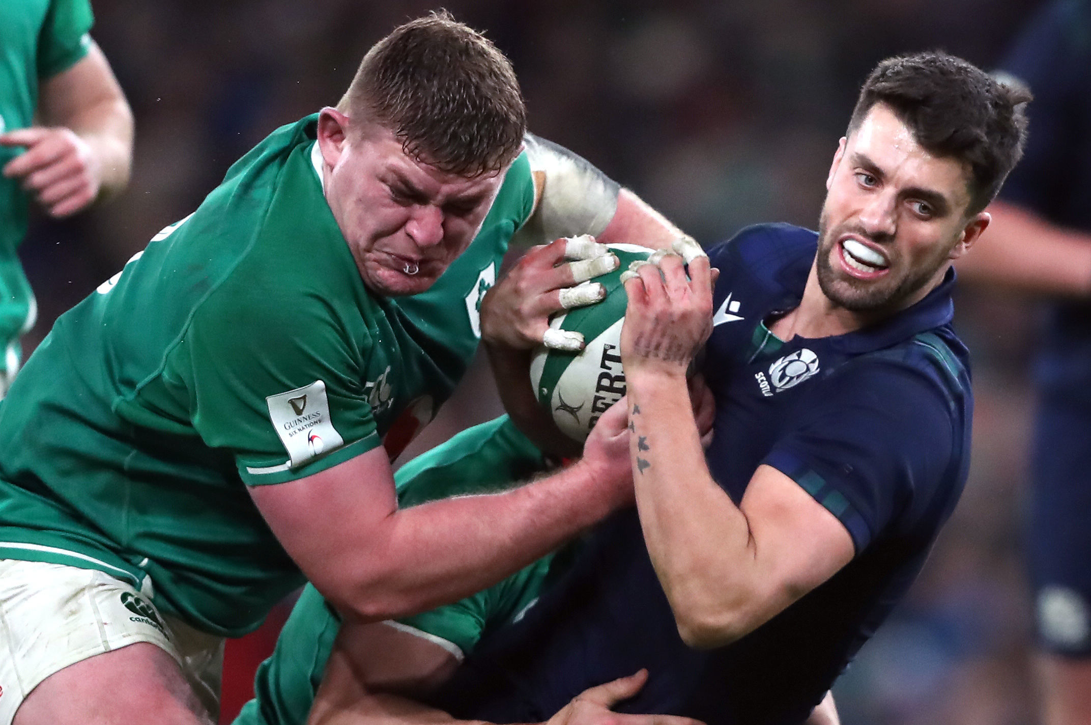 Adam Hastings fights for space with Tadhg Furlong during Saturday's game in Dublin.