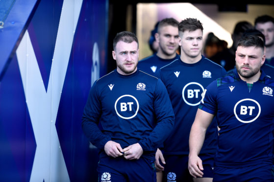 Captain Stuart Hogg (left) leads out the Scotland team for the captain's run at Murrayfield ahead of the Scotland-England game in February.