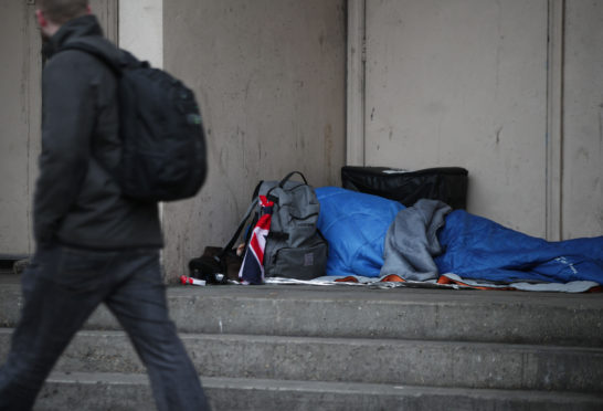 EMBARGOED TO 0001 SUNDAY NOVEMBER 26  File photo dated 07/02/17 of a person sleeping rough in a doorway. A cross-party group of MSPs has called for the Scottish Government to introduce a seven-day limit for homeless B&B use. PRESS ASSOCIATION Photo. Issue date: Monday November 26, 2018. A report by homelessness charity Crisis indicated that 84% of 74 people stuck living in B&Bs, hotels or unsupported hostels felt isolated by their living situation. See PA story SCOTLAND Homelessness. Photo credit should read: Yui Mok/PA Wire
