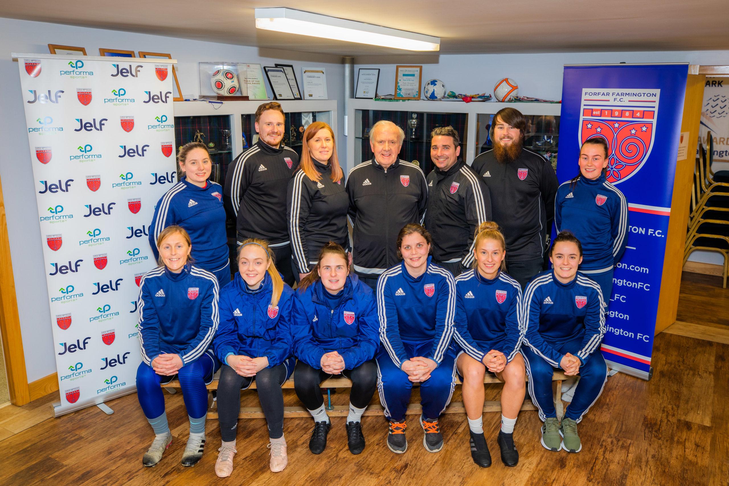 Farmington players with (back) assistant coach Paul Nicol, development officer Nicola McBride, chairman Colin Brown, head coach Ryan McConville and goalkeeping coach Fraser Reid.