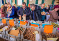 Visitors check out the stalls at Coupar Angus Town Hall during Strathmore Tattie Day
