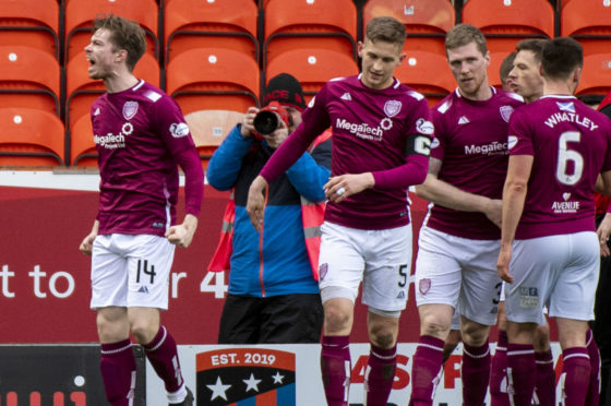 Craig Wighton, left, celebrates after scoring only goal of the game.