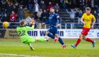 Kane Hemmings scores Dundee's second goal.