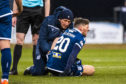 Ross Callachan is treated after suffering the serious injury.