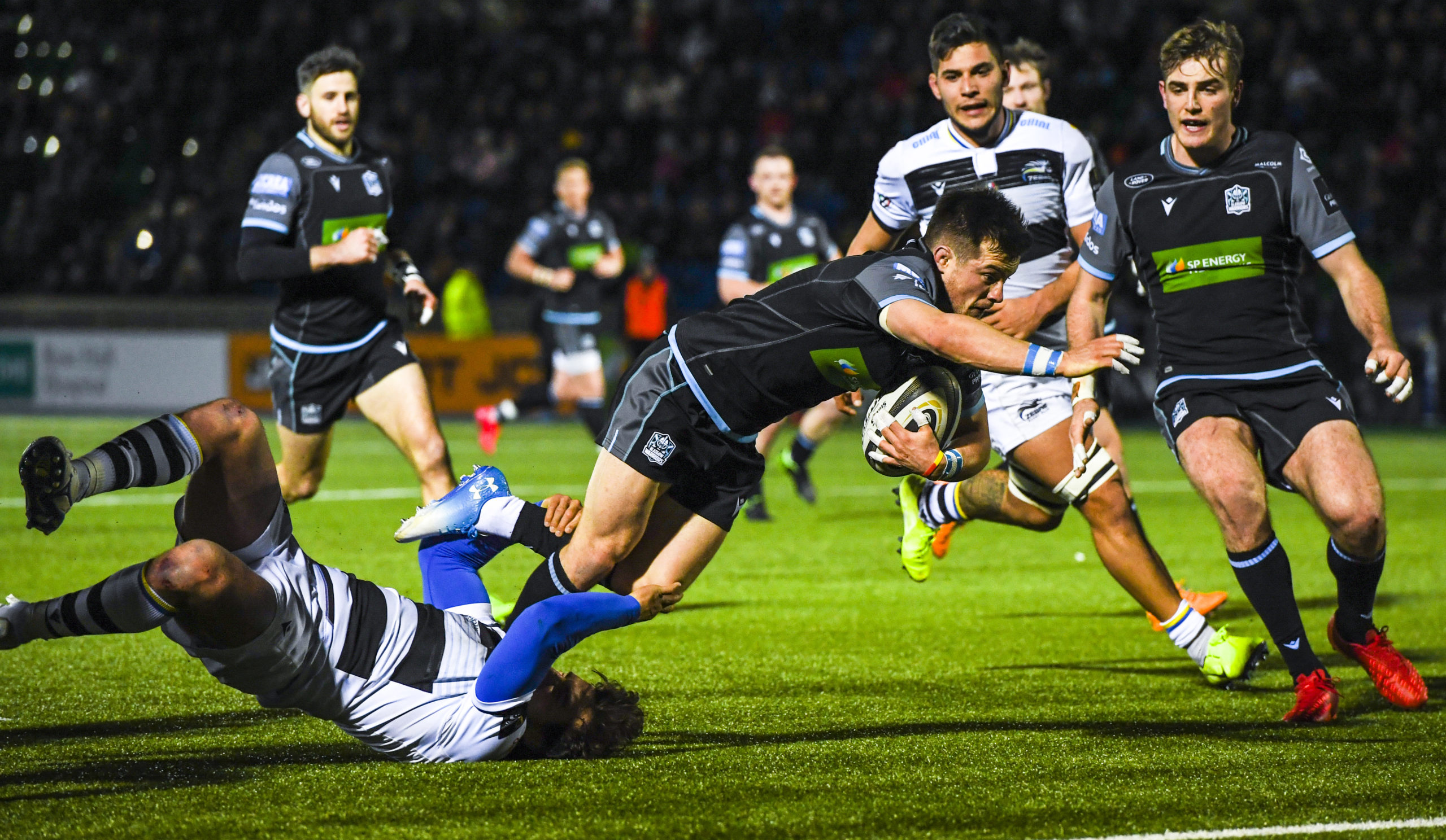 George Horne scores his second try of the night for Glasgow.