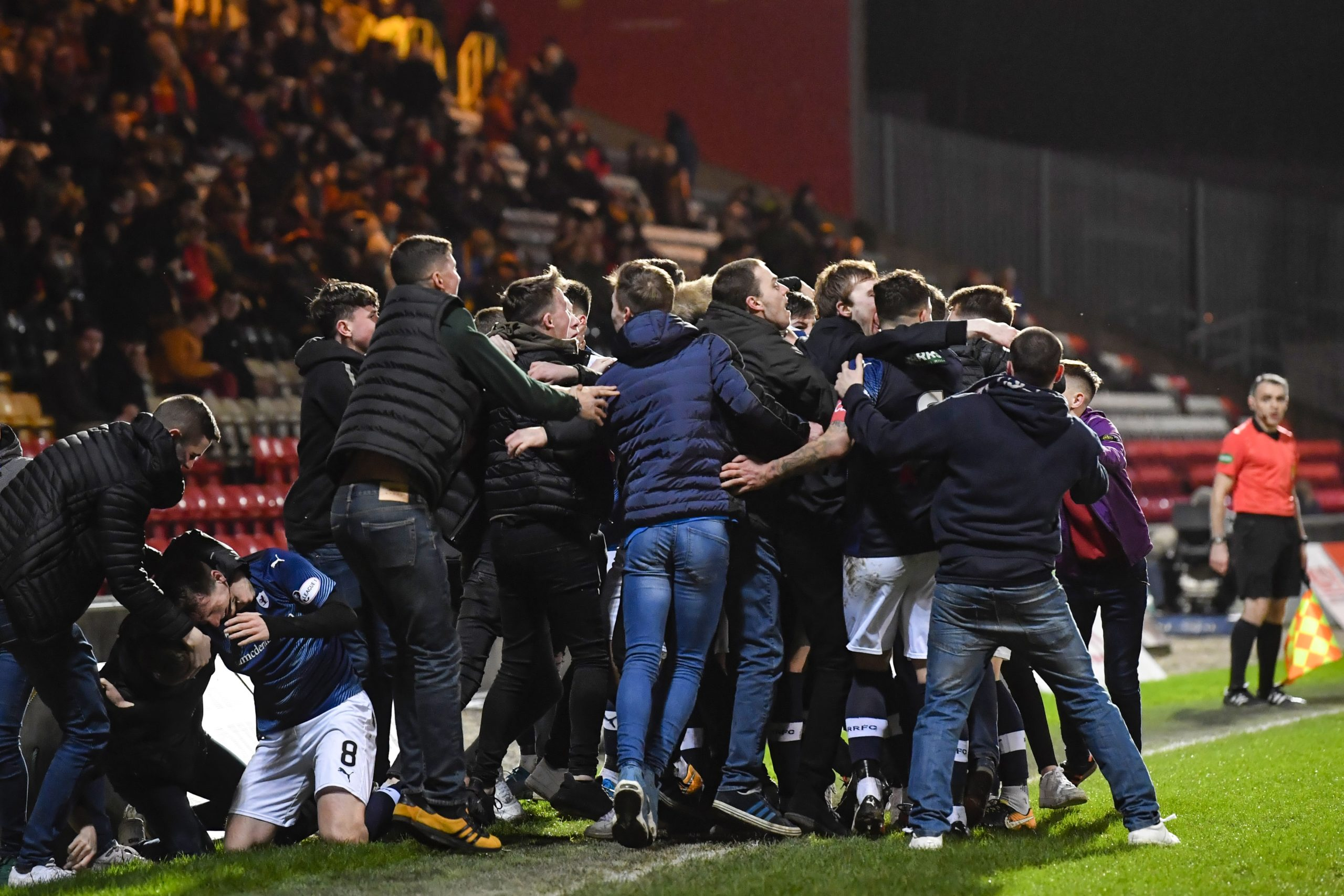 The Raith Rovers fans invade the pitch after Regan Hendry's goal during the 2-1 semi-final win at Firhill.