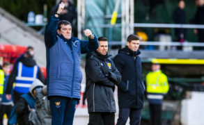 Tommy Wright, left, sends out instructions as Steven Gerrard, right, looks on.