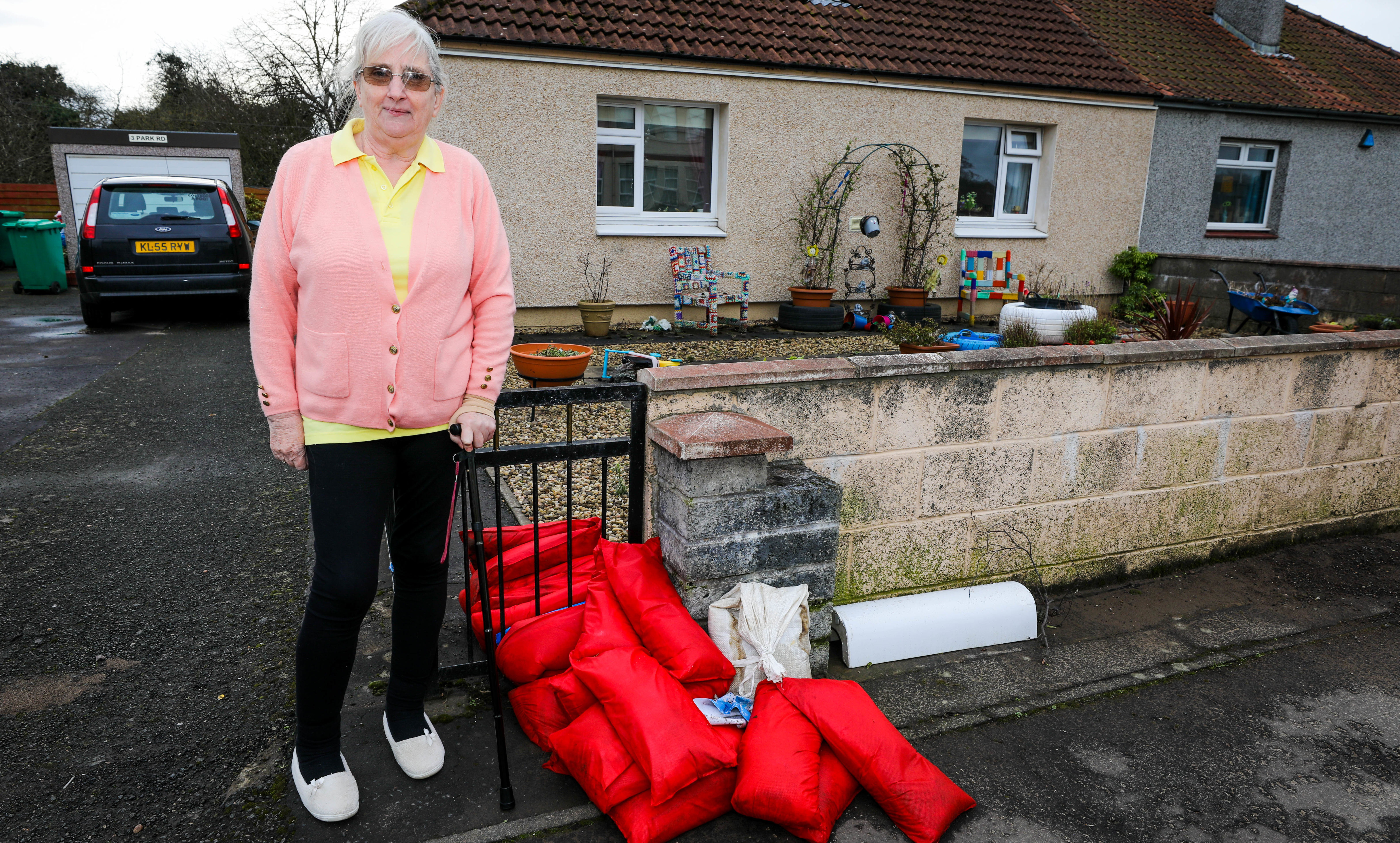 Annette Young outside her home.