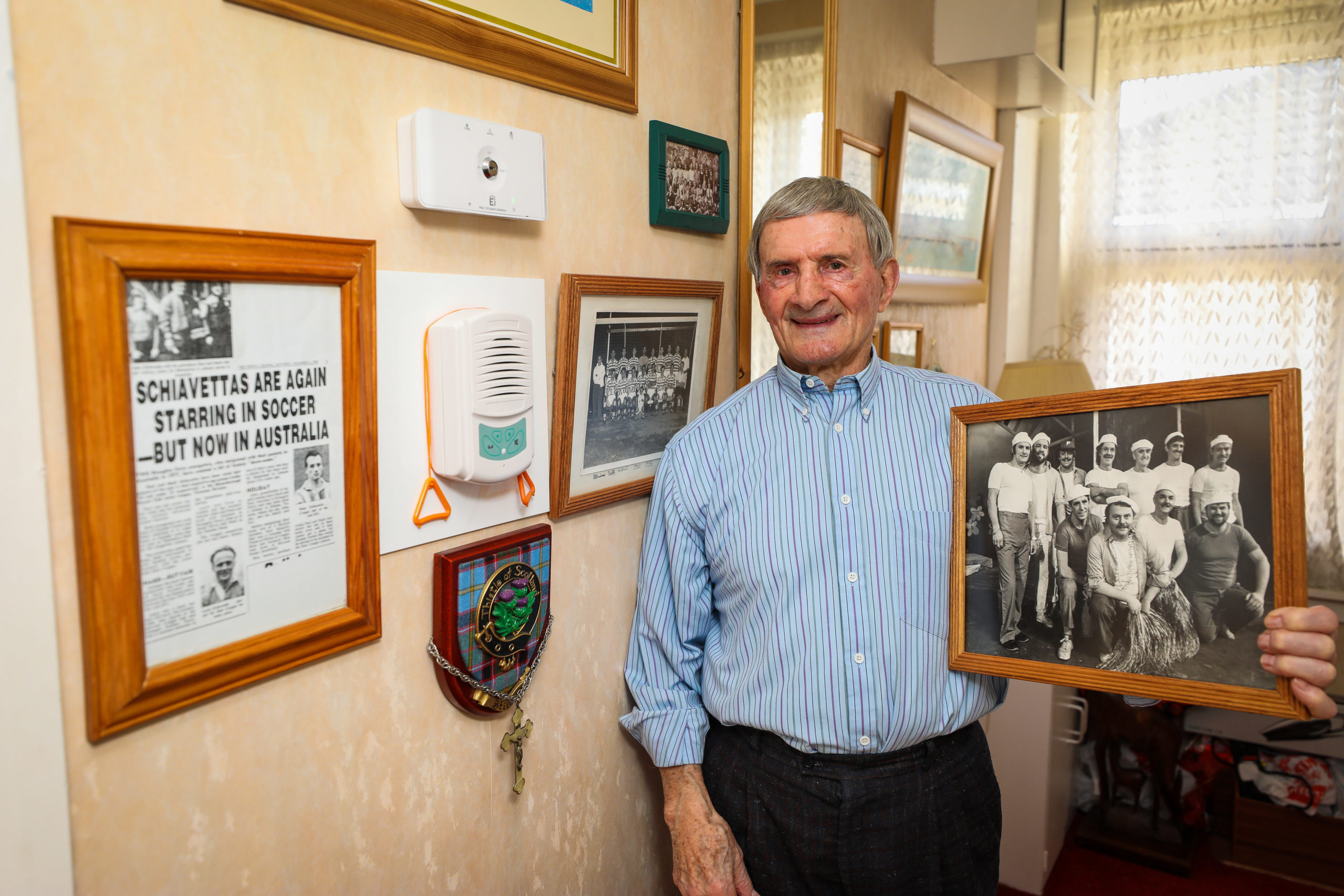 Peter Schiavetta (84) with family photographs relating to the Ben Attow fishing disaster.